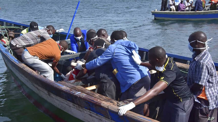 Rescuers retrieve a body from the water near Ukara Island, in Lake Victoria, Tanzania, Sept. 21, 2018, after the passenger ferry MV Nyerere capsized on the lake.