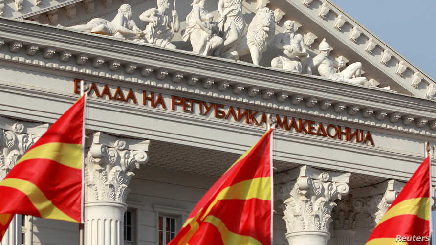National Macedonian flags flutter in front of the government building in Skopje, Macedonia, June 12, 2018.