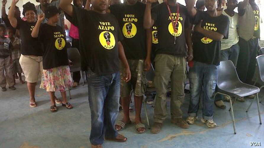 AZAPO members sing protest songs at a recent Johannesburg meeting. (Courtesy AZAPO)
