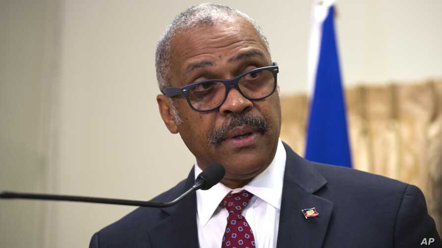 FILE - Haiti's newly nominated Prime Minister Dr. Jack Guy Lafontant speaks at the national palace during a ceremony in Port-au-Prince, Haiti.