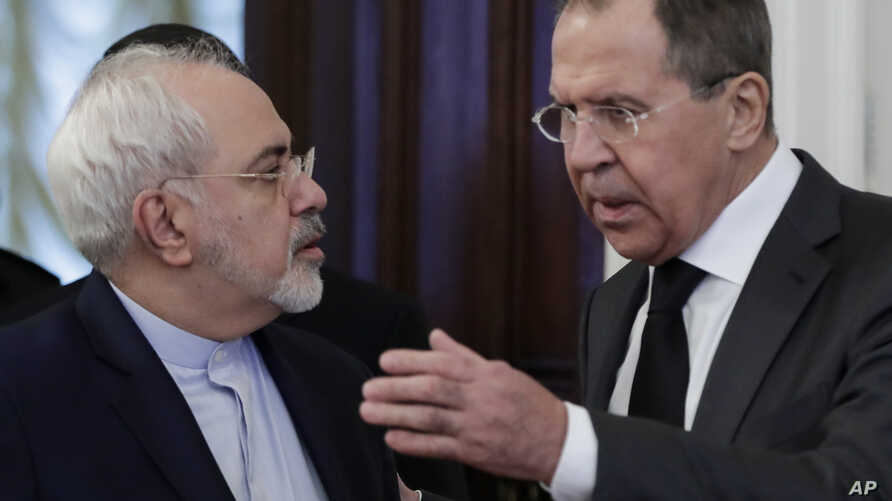 FILE - Russian Foreign Minister Sergey Lavrov, right, speaks to Iranian Foreign Minister Mohammad Javad Zarif as they enter a hall for the talks in Moscow, Russia, Dec. 20, 2016. In the past few years an alliance — at times shaky — between Moscow and