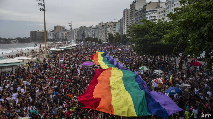 FILE - A giant rainbow flag is pictured during the Gay Pride parade at Copacabana beach in Rio de Janeiro, Brazil, Sept. 30, 2018.