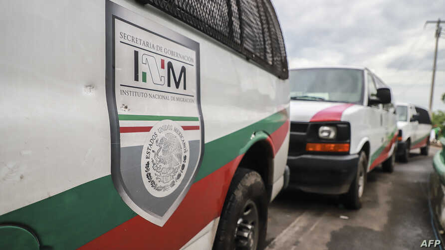 FILE - Vans of Mexico's National Migration Institute (INM) are seen at a checkpoint on the outskirts of Tapachula, Chiapas State, Mexico, June 12, 2019. The head of the National Migration Institute, Tonatiuh Guillén López, has resigned.