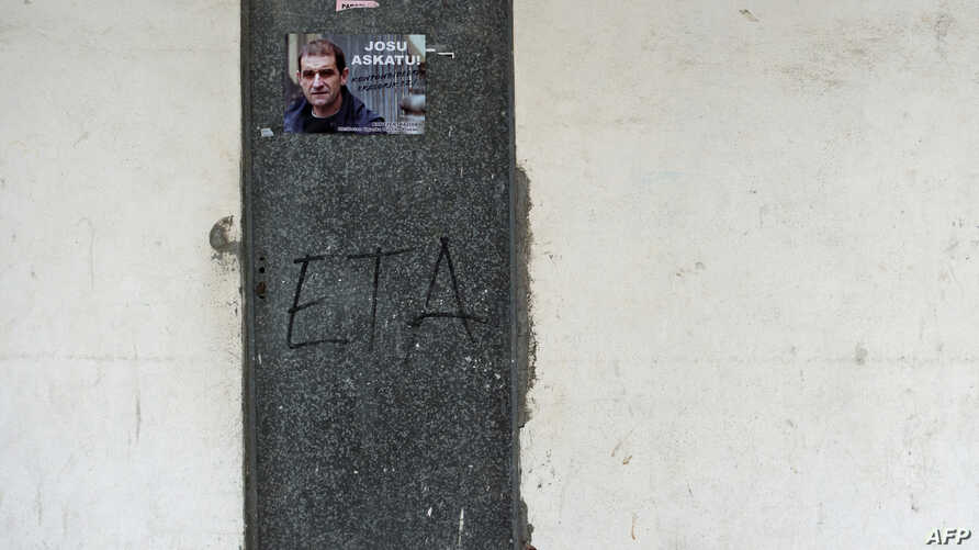 FILE - A poster is pasted on a door calling for the release of one of the most influential leaders of former Basque separatist group ETA, Josu Ternera, in the Spanish Basque village of Miraballes, May 16, 2019, after he was arrested in France.
