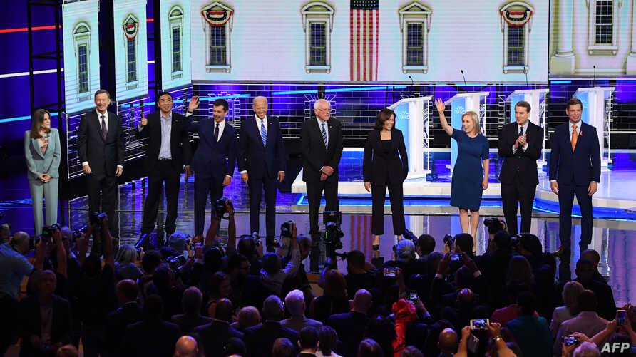 Democratic presidential hopefuls, from left, Marianne Williamson, John Hickenlooper, Andrew Yang, Pete Buttigieg, Joseph R. Biden, Bernie Sanders, Kamala Harris, Kirsten Gillibrand, Michael Bennet, and Eric Swalwell in Miami, June 27, 2019.