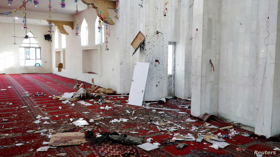 Hats are seen inside a mosque after a blast in Kabul, Afghanistan, May 24, 2019.
