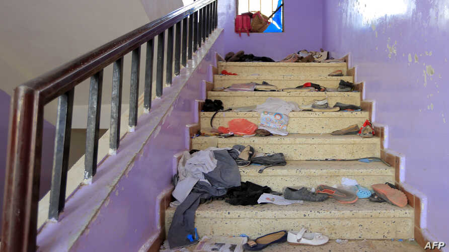 The belongings of Yemeni students are seen scattered on a staircase bearing blood stains at a school in the capital Sanaa  on April 7, 2019, following reports about an explosion near the school which Huthi rebels blamed on the Saudi-led coalition, wh...