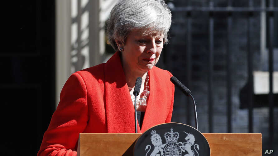 British Prime Minister Theresa May reacts as she turns away after making a speech in the street outside 10 Downing Street in London, England, May 24, 2019.
