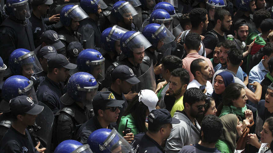 Students face police officers during a protest in Algiers, May 21, 2019.