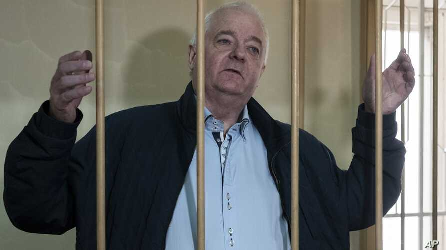 FILE - Norwegian national Frode Berg, who is accused of spying on Russia, stands in a cage in Lefortovo district court in Moscow, Russia, Oct. 1, 2018.