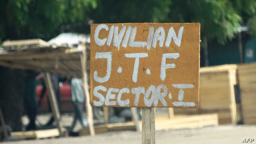 FILE - A sign near a checkpoint of a vigilante group reads Civilian J.T.F or Civilian Joint Task Force in Maiduguri, July 19, 2013.