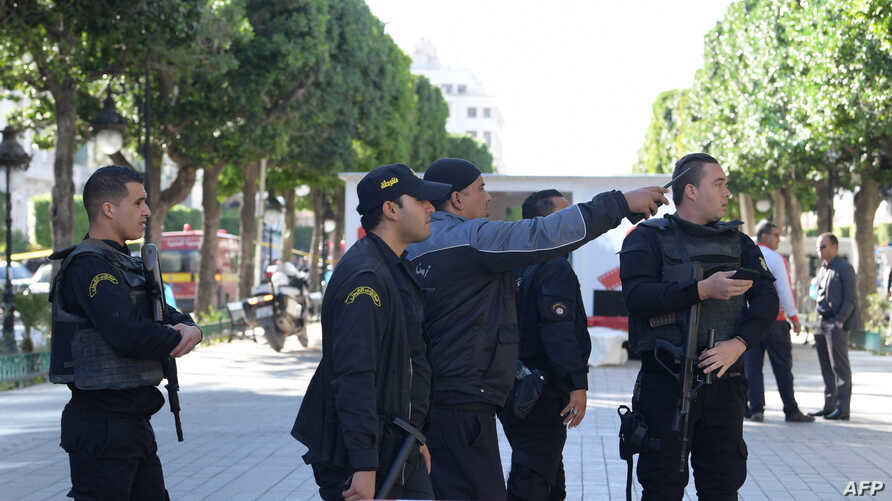 FILE - Tunisian police gathering at the site of a suicide attack in the centre of  Tunis, Oct. 29, 2018.