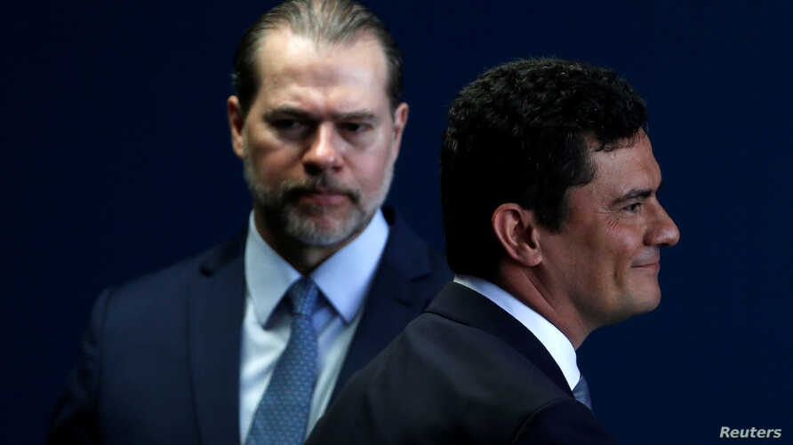Brazil's new Justice Minister Sergio Moro attends his handover ceremony as the President of the Supreme Federal Court Dias Toffoli looks on, in Brasilia, Brazil, Jan. 2, 2018.