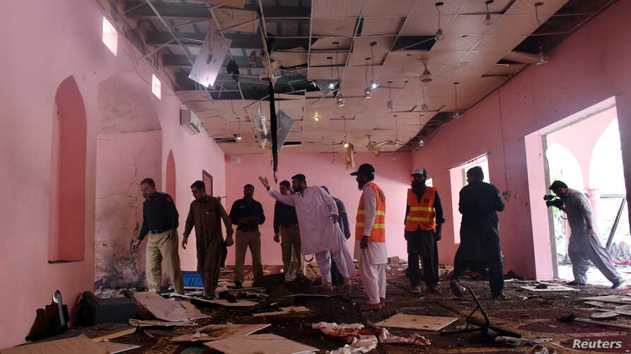 Police officers and rescue workers gather at the site after a blast in a mosque in Quetta, Pakistan, May 24, 2019.