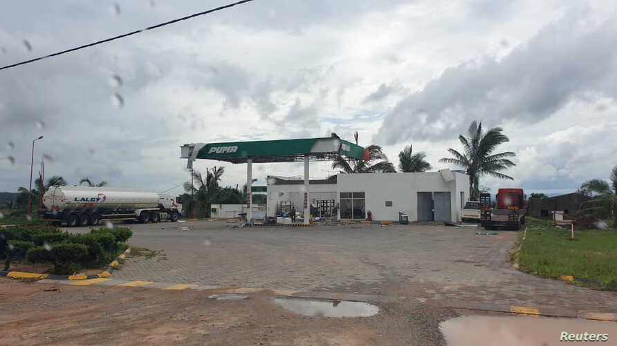 A damaged Puma Energy gas station is pictured from inside a vehicle after Cyclone Kenneth swept through the region in Cabo Delgado province, Mozambique, April 26, 2019, in this image obtained from social media.