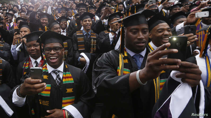 FILE - Members of a graduating class take pictures at their graduation ceremony at Morehouse College in Atlanta, Georgia, May 19, 2013.