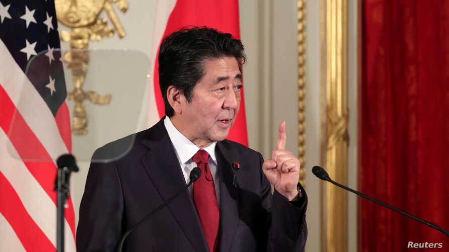 FILE - Japan's Prime Minister Shinzo Abe speaks during a joint news conference with US President Donald Trump (not seen), at Akasaka Palace in Tokyo, Japan, May 27, 2019.
