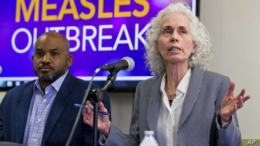Los Angeles County Department of Public Health experts, Muntu Davis, Health Officer, left, and Director Dr. Barbara Ferrer answer questions regarding the measles response and the quarantine orders during a news conference in Los Angeles Friday, April...