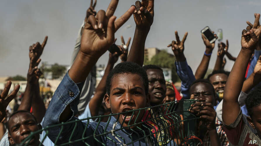 FILE - Sudanese protesters rally in the capital Khartoum, Apr. 26, 2019.