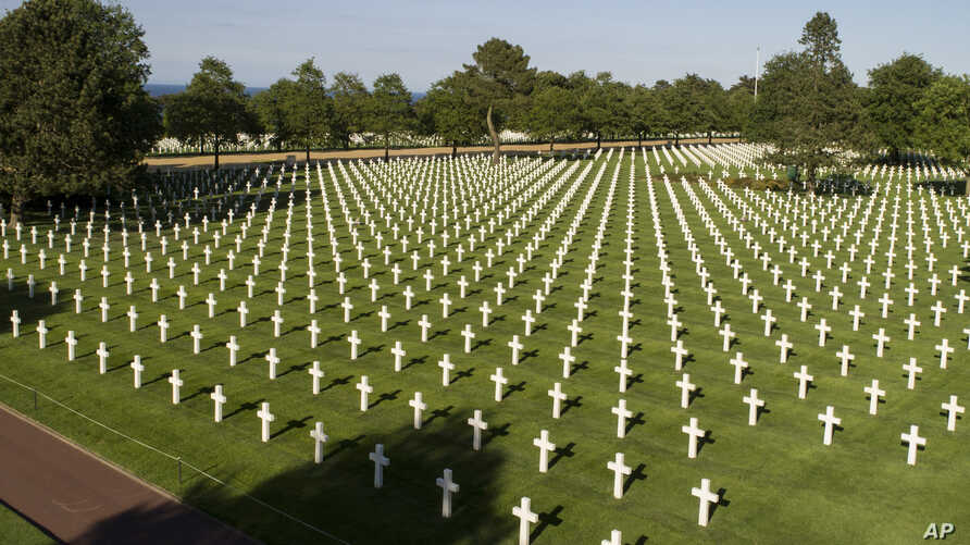 Photo taken by drone shows crosses at the American Normandy cemetery in Colleville-sur-Mer, Normandy. In the cemetery of Colleville-sur-Mer, where 9,387 fallen U.S. fighters are buried, May 28, 2019.