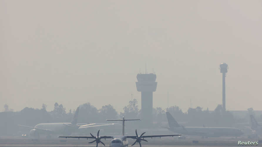 A passenger plane is set to take off at Mexico City's international airport as authorities declared an environmental emergency for   Mexico City as smoke from wildfires pushed pollution to harmful levels in Mexico City, May 14.