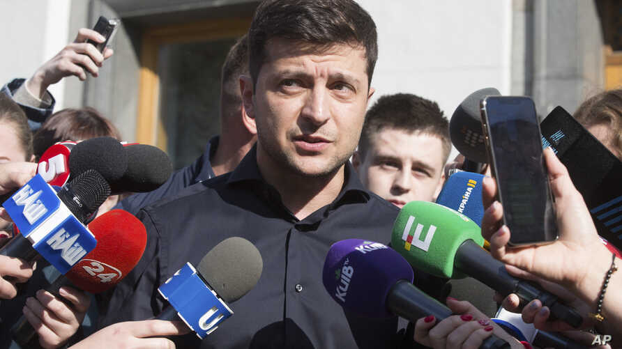 FILE - Ukraine's president-elect Volodymyr Zelenskiy answers questions from the media in front of the parliament building in Kyiv, Ukraine, May 4, 2019