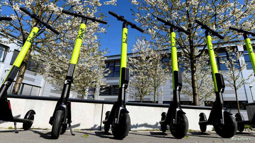FILE - E-scooters are lined up during a presentation at the DESY campus in Hamburg, Germany, April 16, 2019.