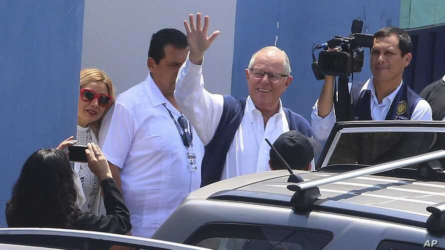 In this photo provided by the Andina News Agency, former Peruvian President Pedro Pablo Kuczynski waves as he leaves a medical branch of the prosecutor's office, in Lima, Peru, April 10, 2019.