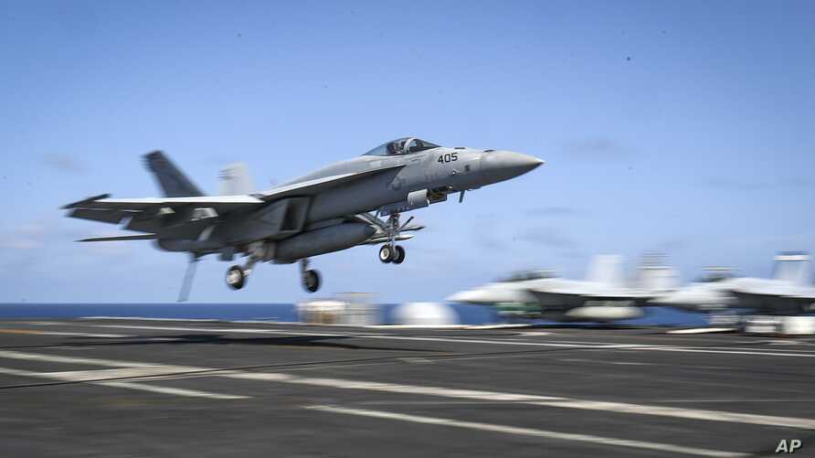 An F/A-18E Super Hornet lands on the flight deck of the Nimitz-class aircraft carrier USS Abraham Lincoln in the Arabian Sea, May 20, 2019.