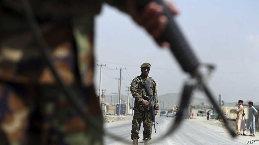 Afghan National Army soldiers stand guard at a checkpoint on the Jalalabad-Kabul road, on the outskirts of Kabul, April 28, 2019.