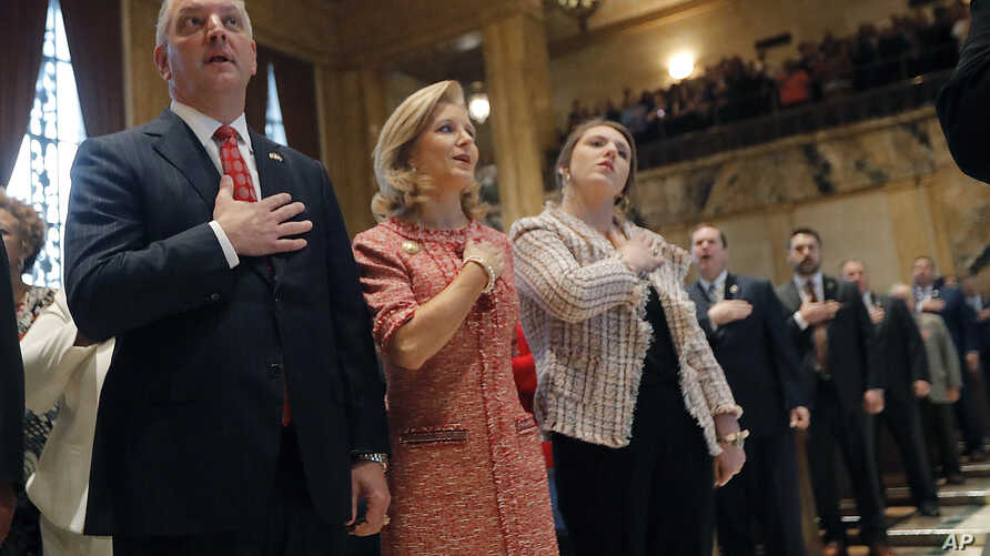 FILE - Louisiana Gov. John Bel Edwards recites the Pledge of Allegiance at the opening of the annual state legislative session in Baton Rouge, April 8, 2019.