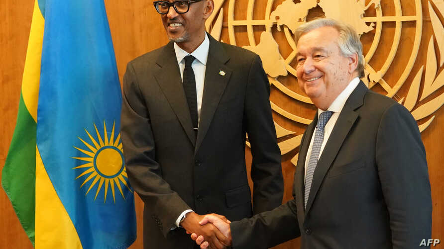 FILE - Rwandan President Paul Kagame, left, is greeted by U.N. Secretary-General António Guterres on Sept. 24, 2018, at U.N. headquaters in New York. On April 12, 2019, the two participated in a tribute to the dead and the survivors of the extremist...