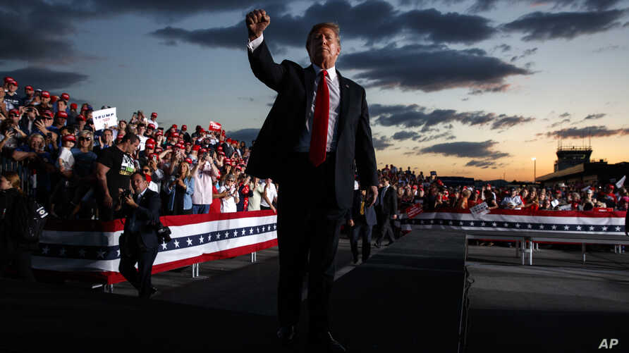 President Donald Trump pumps his fist to the crowd after speaking to a campaign rally in Montoursville, Pa., May 21, 2019.