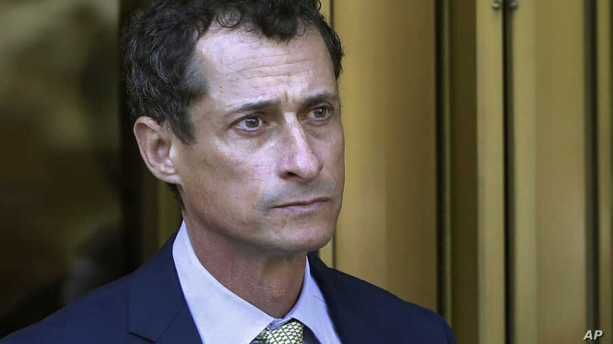 FILE - Former Congressman Anthony Weiner leaves federal court following his sentencing in New York, Sept. 25, 2017.