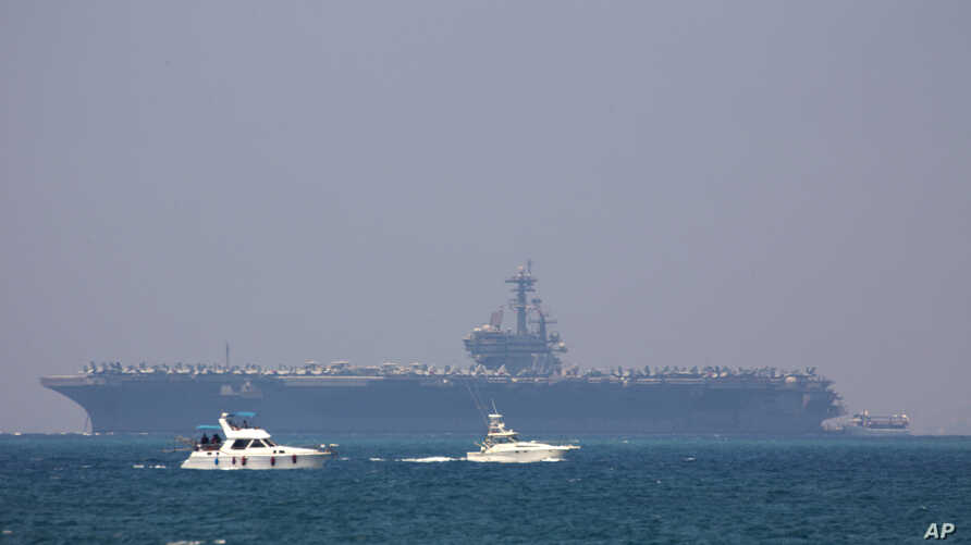 FILE - The United States' Navy USS George H.W. Bush aircraft carrier is seen docked in the Mediterranean Sea off the coast of Haifa, Israel, July 1, 2017.