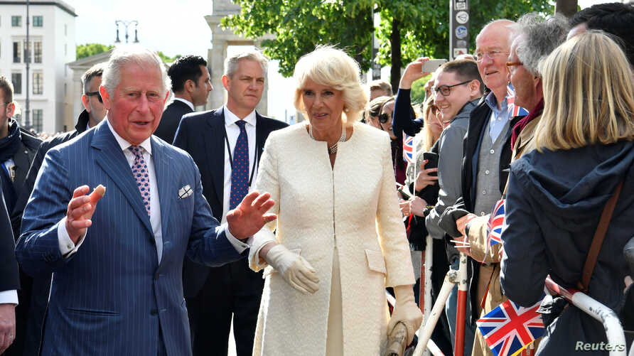 Britain's Prince Charles, Prince of Wales and his wife Britain's Camilla, Duchess of Cornwall greet the crowd during a visit at the Brandenburg Gate in Berlin, Germany, May 7, 2019.