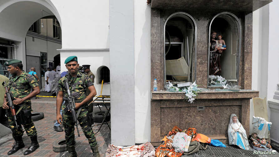 Sri Lankan military officials stand guard in front of the St. Anthony's Shrine, Kochchikade church after an explosion in Colombo, Sri Lanka, April 21, 2019.