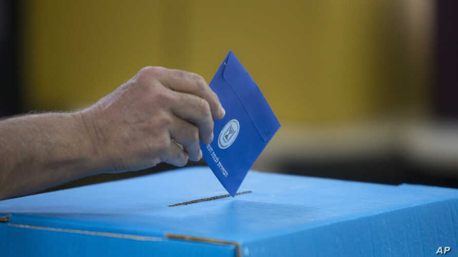 An Israeli man casts his vote during Israel's general elections in Tel Aviv, Israel, April 9, 2019.