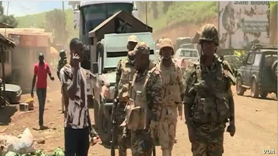 FILE - Cameroon troops watch for separatists in Cameroon's northwest region, Bamenda, Cameroon, May 24, 2019.