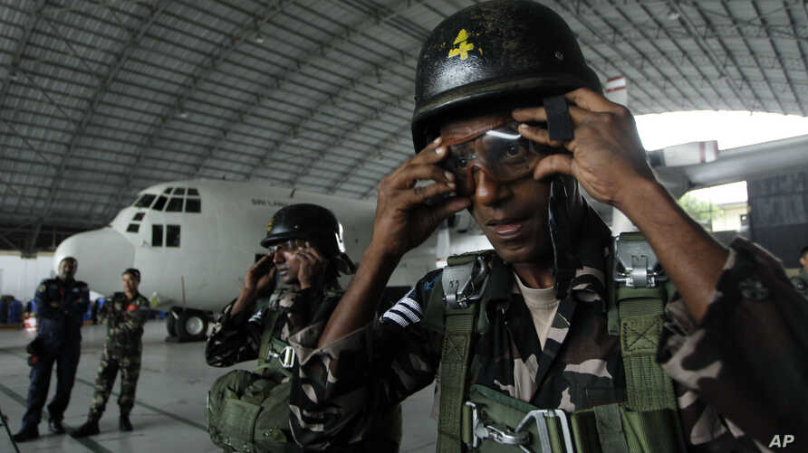 FILE - Sri Lankan air force paratroopers get ready for an exercise at an air force base in Ratmalana, a suburb of Colombo, Sri Lanka.