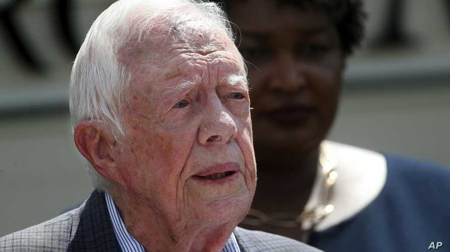 FILE - Former U.S. president Jimmy Carter speaks during a news conference, in Plains, Georgia, Sept. 18, 2018.