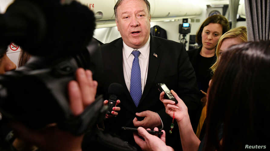 U.S. Secretary of State Mike Pompeo speaks to reporters in flight after a previously unannounced trip to Baghdad, Iraq, May 8, 2019.