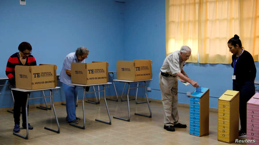 A man casts his ballot during the general election in Panama City, Panama, May 5, 2019.