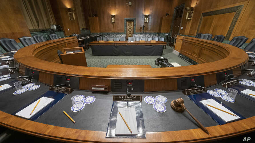 The Senate Judiciary Committee hearing room is prepared for Attorney General William Barr who will face lawmakers' questions Wednesday for the first time since releasing special counsel Robert Mueller's Russia report, on Capitol Hill in Washington, A...