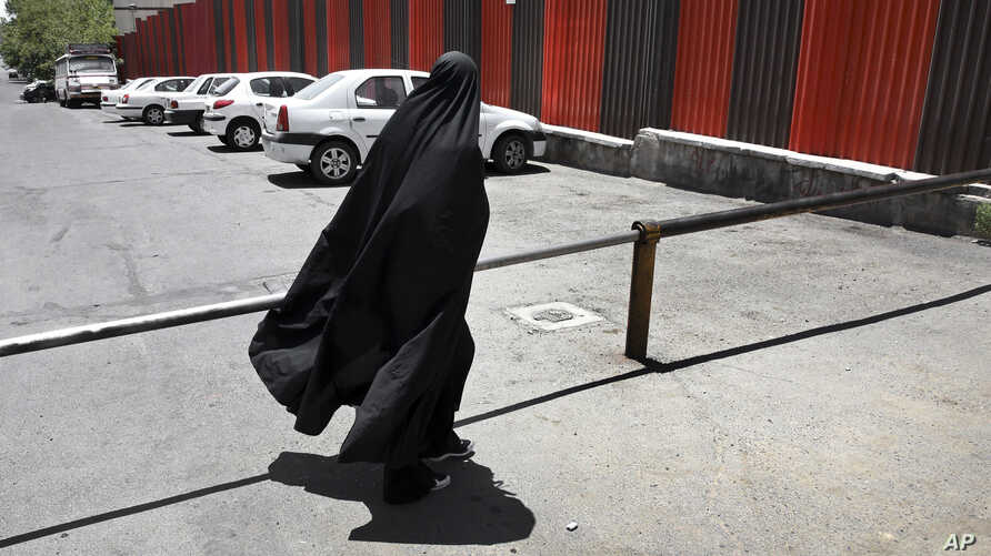 FILE - A woman is seen leaving the Revolutionary Court in Tehran, Iran, July 13, 2015.