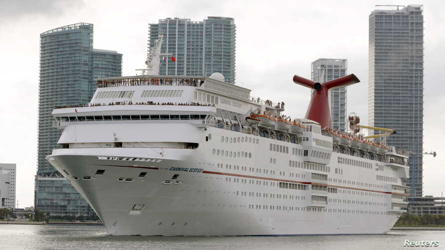 FILE - The Carnival cruise ship Ecstasy leaves the port in Miami, Florida, Sept. 18, 2015.