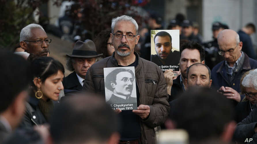 Protesters hold portraits of Armenian intellectuals during a rally held to commemorate the 104th anniversary of the 1915 mass killing of Armenians in Istanbul, April 24, 2019.