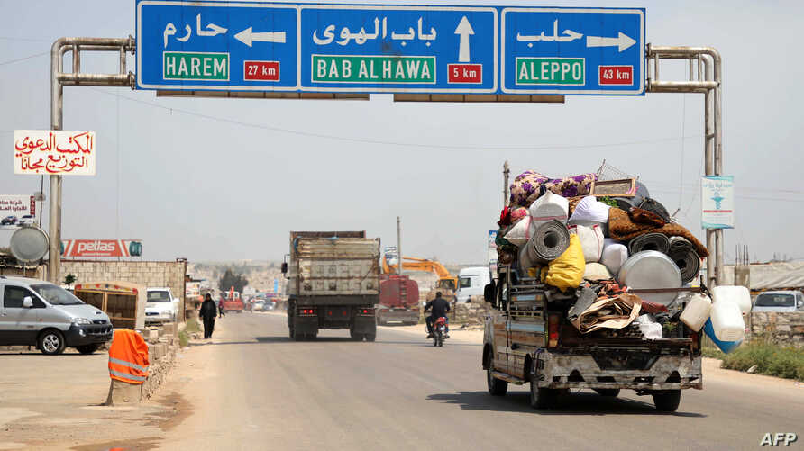 A truck loaded with belongings of a family is seen as they flee from reported regime shelling on Hama and Idlib provinces, May 1, 2019.