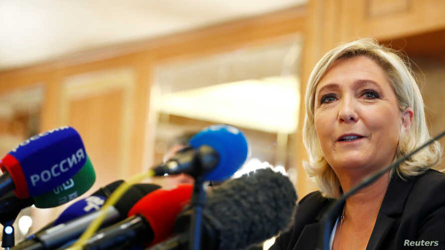 Leader of France's National Rally Party Marine Le Pen speaks during a news conference in Milan, Italy, May 18, 2019.
