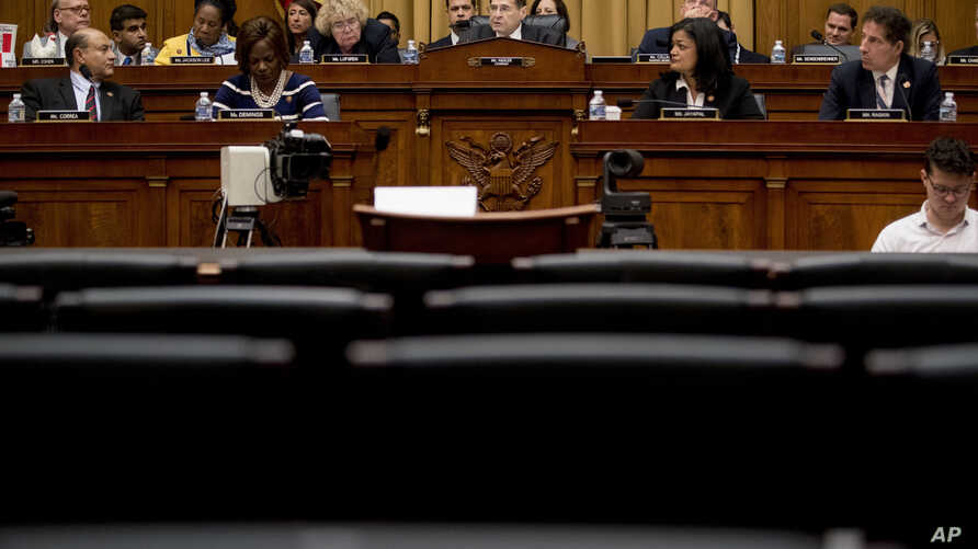 The witness chair reserved for Attorney General William Barr sits empty as Judiciary Committee Chairman Jerrold Nadler, D-N.Y., center background, gives his opening statement at a House Judiciary Committee hearing on Capitol Hill in Washington, May 2...